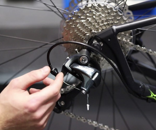 adjust the cable tension on the rear cassette of your bike