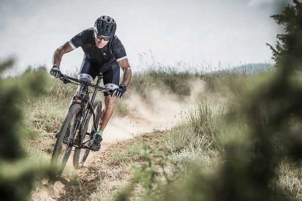Mountain Biker on a dusty trail