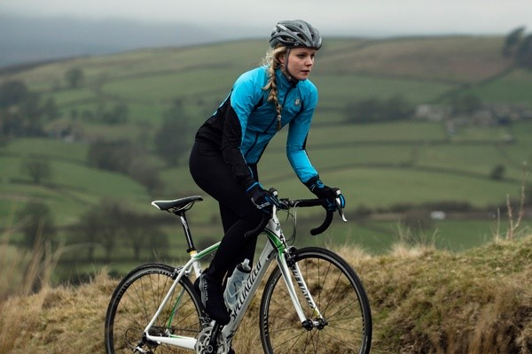 Female cyclist wearing a long sleeve jersey