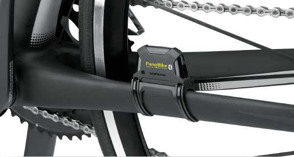 Close up view of a Panobike sensor attached to the frame next to the rear wheel of the bike