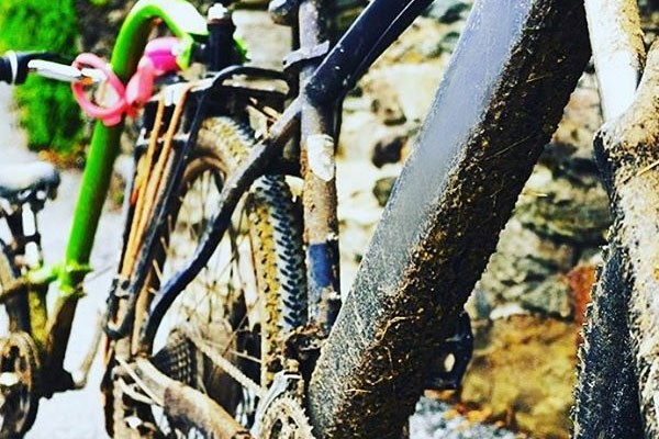 Muddy kids tag along bike