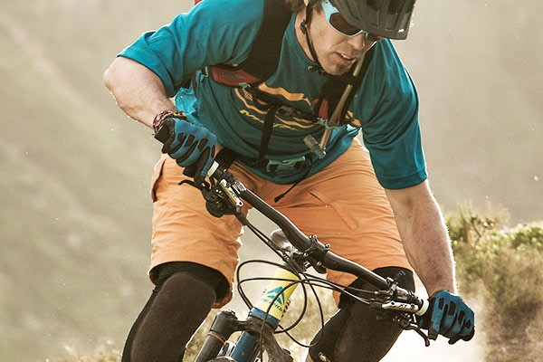 Mountain biker wearing full finger gloves with knuckle protection