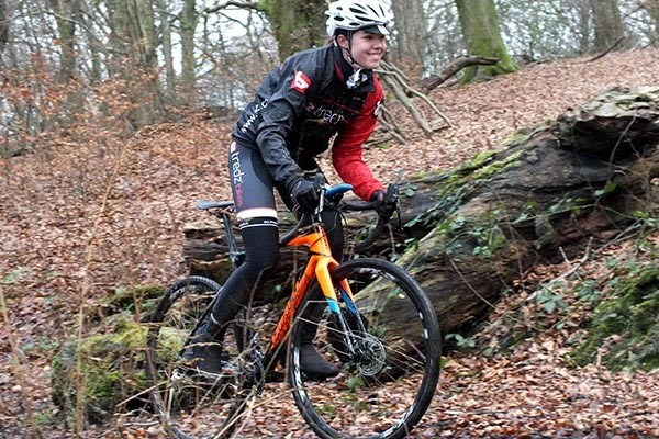Team Rider Alex Thomas in a Giant cyclocross bike in a woodland setting