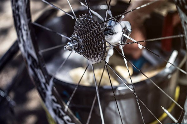 A close up of a Cassette, Wheel and its rim.