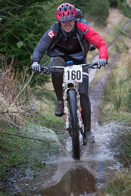 Team Tredz rider Alex tackles a puddle