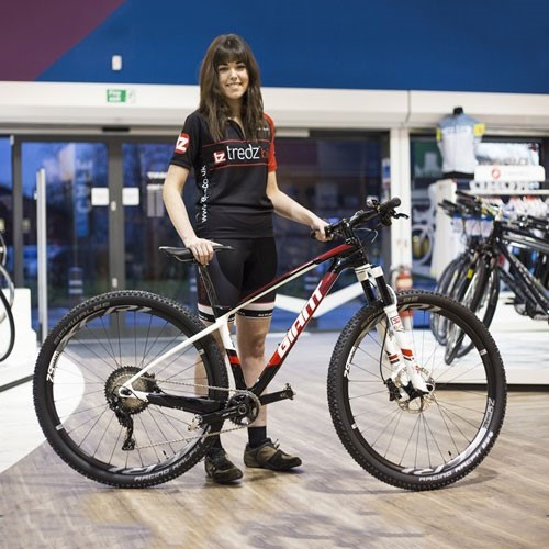 Team Tredz Rider Alex with her new bike in the Giant store