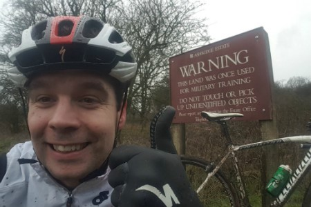 dave in front of a warning sign