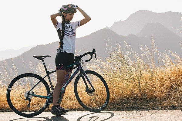 Women road cyclist wearing Liv clothing