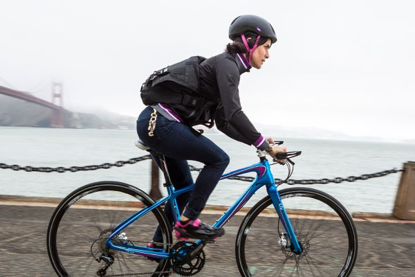 Female cyclist commuting to work