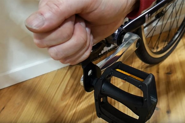 Remove the pedal carefully with a spanner or Allen key, TWIST THE TOOL TOWARDS THE REAR WHEEL OF THE BIKE