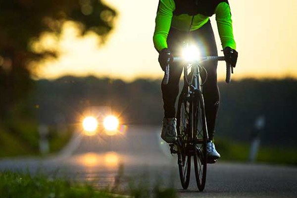 Road cyclist with a bright front light