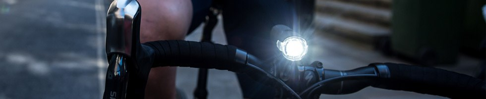 Cyclist with front bike light