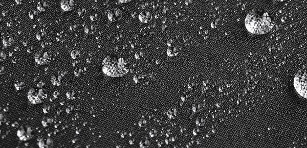 Close-up of water beading up on waterproof bib tights