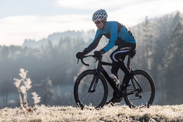 Cyclist wearing bib tights on a chilly winter day