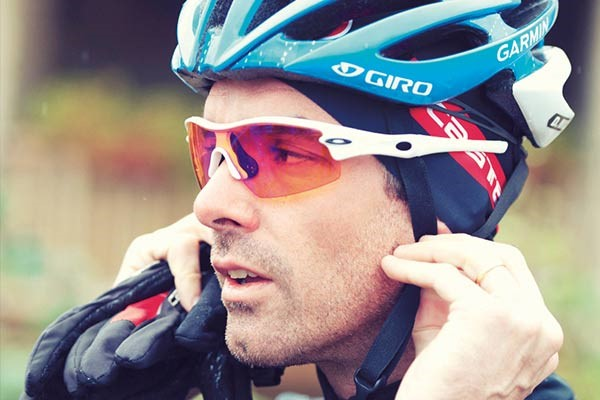 Road cyclist wearing Giro helmet and Oakley sunglasses