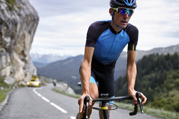 Road cyclist wearing slim fitting jersey