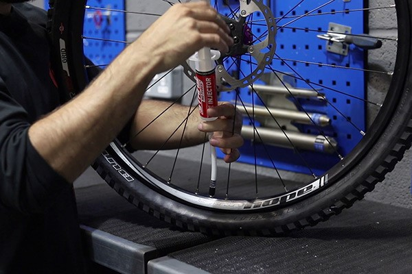 Injecting the sealant into your bike tyre