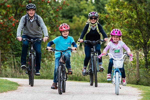 Family riding on a cycle path