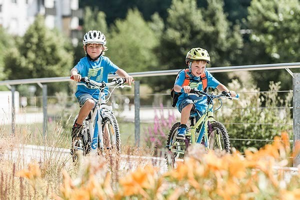 Two 20 inch kids bikes on a cycle path