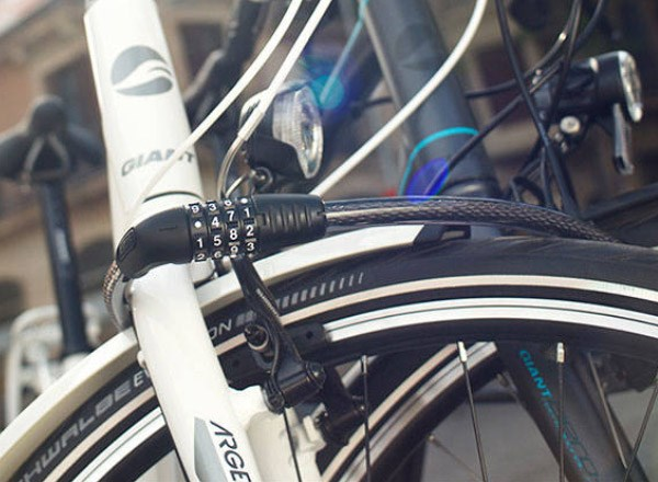 Close up view of a hybrid bike locked up with a Combination cable lock